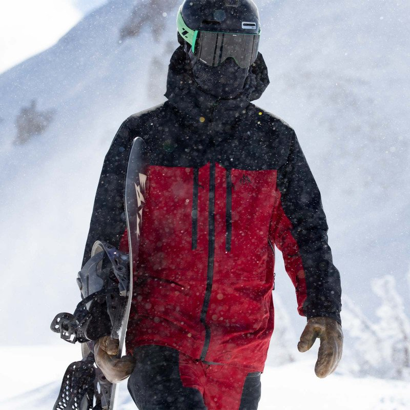 Jones team rider Harry Kearney wearing the Shralpinist 3L GORE-TEX PRO jacket in safety red