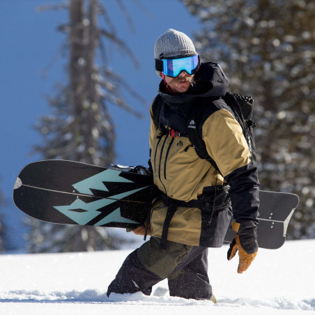 Jones team rider Taylor Carlton wearing the Mountain Surf parka in Summit Khaki