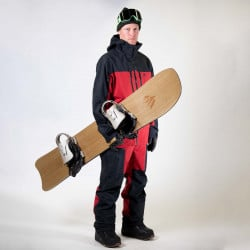 Jones team rider Harry Kearney wearing the Shralpinist 3L Gore-Tex Pro pants in safety red